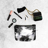 Cosmetiquera transparente con hojas summer negras|carulla.com