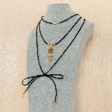 Collar Atrapasueño en Oro Goldfield|carulla.com